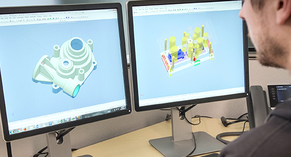 application engineer examining injection molding CAD file