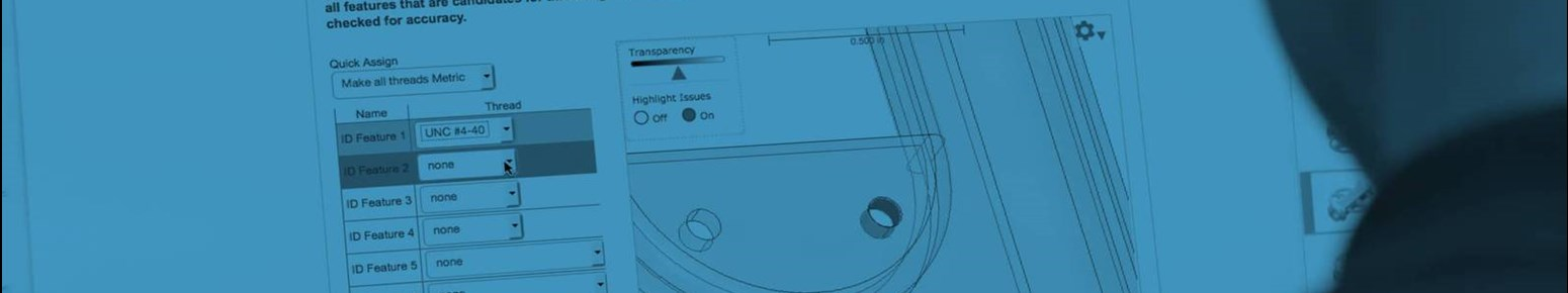 applications engineer examines a part